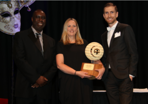 Photograph of the winner of the 2019 New Zealand Project Manager of the Year Award; Raewyn Cummings, together with president of the PMINZ chapter Kosam Nyamdela and Mike Roberts, Director and Principal Trainer at Millpond.